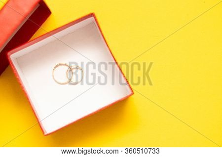 Wedding Rings In A Red Box. Wedding. Newlyweds. A Selection Of Wedding Rings. Advertising About The
