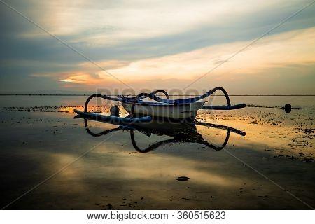 Seascape. Fisherman Boat. Sunrise Landscape. Traditional Balinese Boat Jukung. Fishing Boat At The B