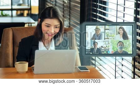 Close Up Happy Charming Young Asian Woman In Formal Wear Sitting And Meeting Video Conference With T