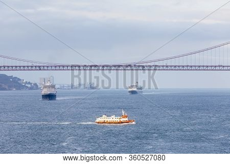 River Tagus.  Ships And Boats Traverse The River Tagus Beside The Port Of Lisbon In Portugal.