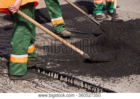Repair Of Roads, Highways And Sidewalks. Patching. Working With A Shovel Falls Asleep In The Pit.