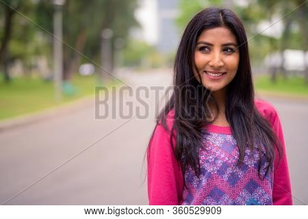 Happy Young Beautiful Persian Woman Thinking At The Park