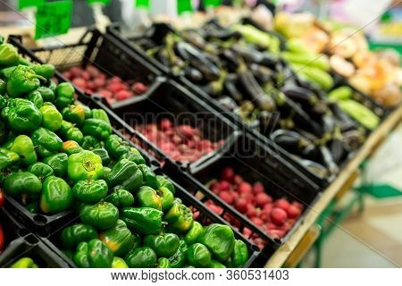 Lots Of Vegetables In The Produce Aisle At A Supermarket.