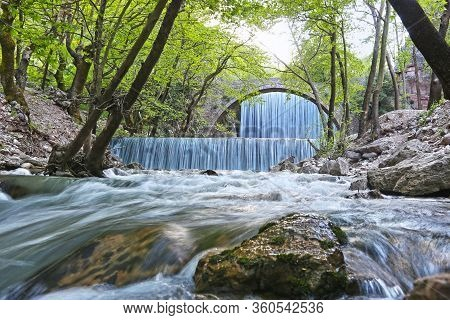 The Waterfall Of Palaiokaria In Trikala Thessaly Greece - Stony Arched Bridge Between The Two Waterf