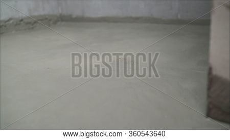 Workers Cover The Concrete Screed With Mortar And Make Waterproofing. The Process Of Waterproofing T