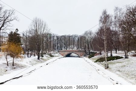 Riga Canal.  A Winter View Along A Frozen Riga Canal.  The Canal Flows Through Bastion Hill Park In