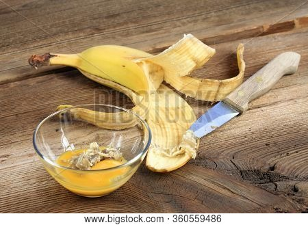 Nourishing Banana Peel Face Mask. Homemade Face Mask Made From Egg Yolk And Inside Part Of Banana Pe