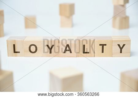 Modern Business Buzzword - Loyalty. Word On Wooden Blocks On A White Background. Close Up.