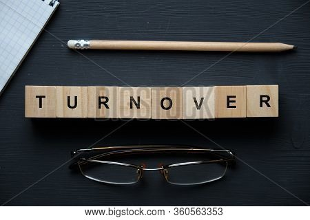 Modern Business Buzzword - Turnover. Top View On Wooden Table With Blocks. Top View. Close Up.