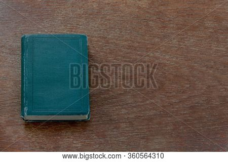 An Old Shabby Book Lies On An Old Shabby Wooden Table With Copy Space. Close-up. Warm Colors.