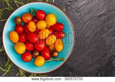 Bowl Of Colorful Cherry Tomatoes (red, Garnet And Yellow), Fresh And Raw. With Water Drops And Rosem