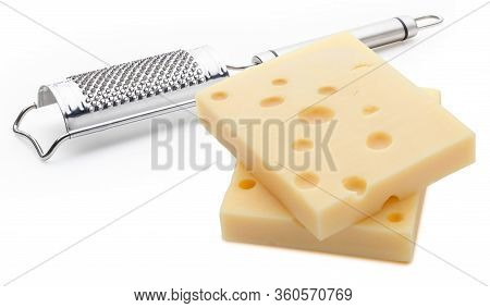 Two Portions (blocks) Of Emmental Swiss Cheese With A Grater. Texture Of Holes And Alveoli. Isolated