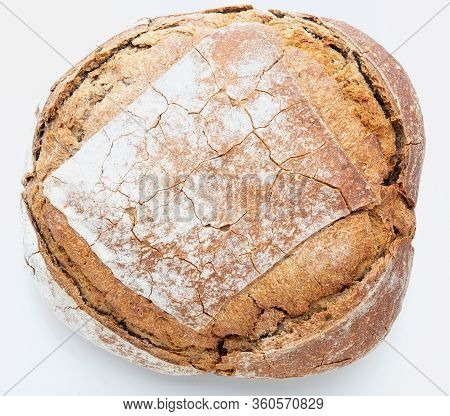 Crispy Rustic Homemade Bread. Top View Of Whole Rye Bread. Isolated On White Background.