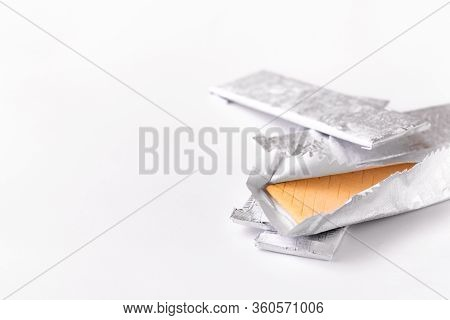Chewing Gum In A Foil Wrapper On A White Background. Group Of Chewing Gums