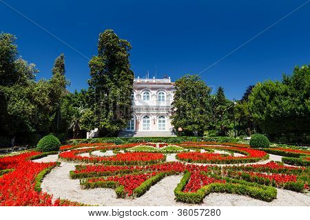 Villa Angiolina With a Beautiful Flowerbed Before an Entrance Opatija Croatia poster