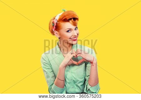Love. Closeup Portrait Smiling Happy Pin Up Woman Making Heart Sign Symbol With Hands Isolated Yello