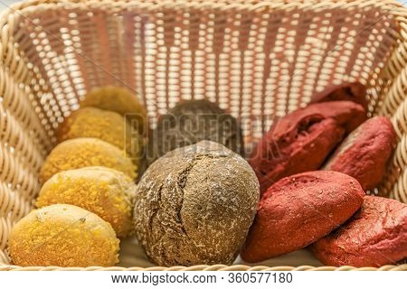Rustic Wicker Basket With A Selection Of Several Loaves Freshly Baked Portuguese Artisan Bread On Di