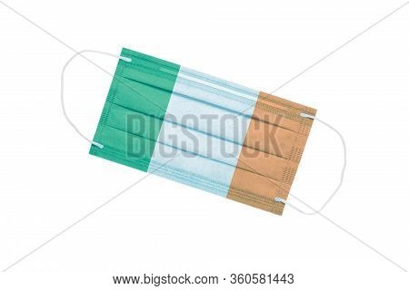 Medical Face Mask With Flag Of Ireland Isolated On A White Background. Ireland Pandemic Concept. Att