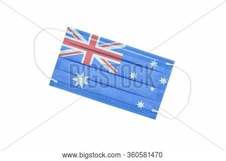 Medical Face Mask With Flag Of Australia Isolated On A White Background. Australia Pandemic Concept.