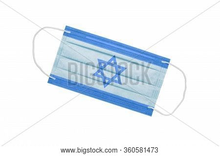 Medical Face Mask With Israel Flag Isolated On A White Background. Pandemic Concept In Israel. Coron