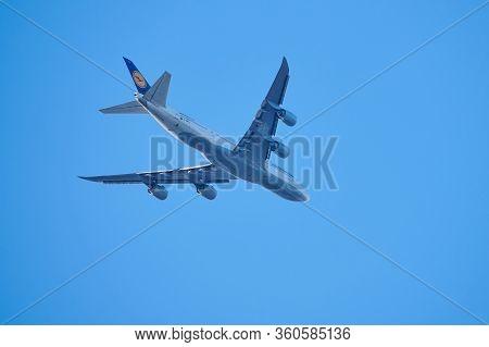 Mainz, Germany - April 10, 2020: Lufthansa Boeing 747-8 Is Flying Over Mainz Near Frankfurt Airport,