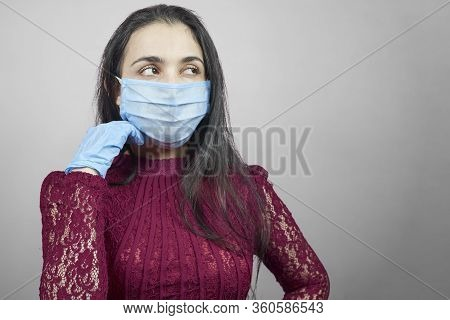 A Young Middle-eastern Woman Wearing Evening Dress And Surgical Mask. Beauty Female In Surgical Mask
