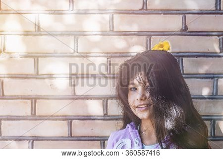 Portrait Of A Beautiful Teen Girl At Outdoors. A Little Girl Having Fun During Summer Vacations. Fac