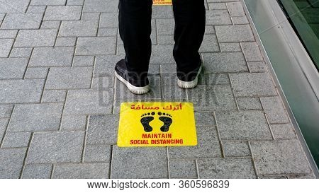 Maintain Social Distancing Stickers Pasted On The Floor In Front Of The Restaurant In Qatar Qatar