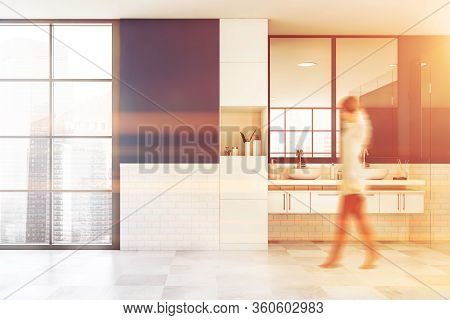 Blurry Young Woman Walking In Luxury Bathroom With Blue And White Brick Walls, Tiled Floor And Comfo