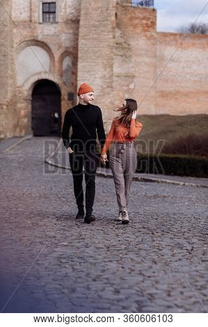 Love Story Of The Beautiful Young Man And Woman Walking On The Open Air The City. Embrace On A City