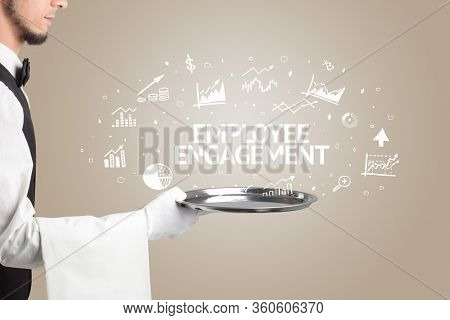Waiter serving business idea concept with EMPLOYEE ENGAGEMENT inscription