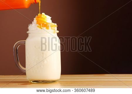 Milkshake Decoration Topping With Chocolate Or Coffee. Dessert Decoration Of Different Milkshakes. D