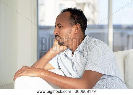 Sad Face Depressed African Man. Very Sad Elderly Man. Portrait Of A Sad Elderly Man Close-up. Lonely
