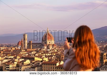 Girl Making A Photo Shoot Of Florence With The Smartphone. Cattedrale Di Santa Maria Del Fiore