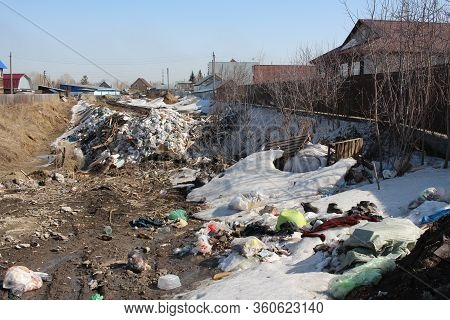 Russia, Novosibirsk 01.04.2020: Garbage Heap Dump On The Road In The Village Unsanitary Household Wa