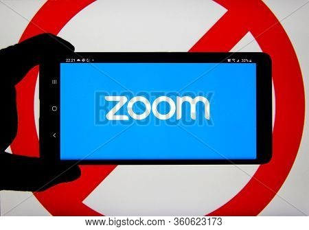 Montreal, Canada - April 9, 2020: Zoom App And Logo On Screen Over Prohibited Ban Sign. Zoom Communi