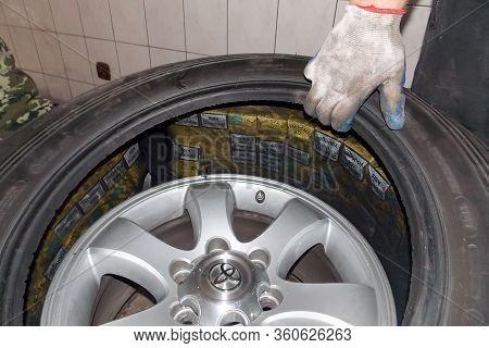 Smilmitsa, Ukraine - October, 2013: Smuggled Cigarettes Hidden In The Spare Wheel (reserve Tire) Of