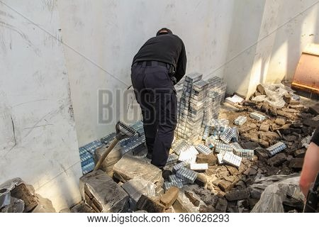 Krakovets, Ukraine - May, 2019: The Border Guard In Special Uniforms Throws Smuggled Cigarettes, Whi