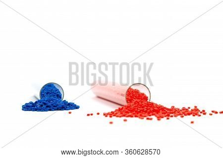 Close-up Of Plastic Polymer Granules. Hand Hold Polymer Pellets. Polymer Plastic. Compound Polymer.