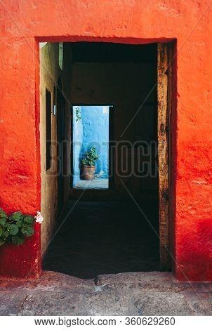 Entrance Door With Colorful Orange And Blue Walls In Santa Catalina De Siena Monastery, Arequipa, Pe