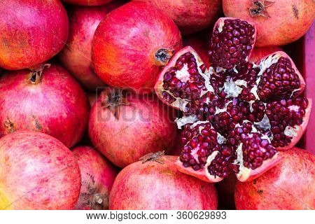 Ripe Juicy Pomegranates On The Counter Of The Turkish Market. Open Pomegranate Fruit. Red Fruit. Eas