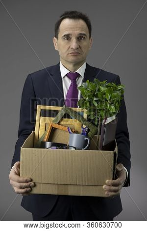 Frustrated Depressed Middle Age Business Owner Close Company. Box In Hands Out Of Business. Bankrupt