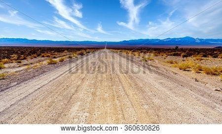 A Long And Straight Gravel Road In The Semi Desert Landscape Near Crystal Springs And Area In The De