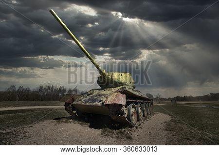 Old Soviet Tank T-34 Of World War Ii, Running On The Grass Field In Rays Of Sun.
