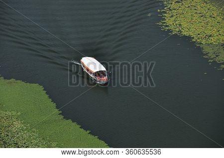 Rijeka Crnojevića, Part Of The Skadar Lake In Montenegro. Tourist Cruises By Boat On The Beautiful M