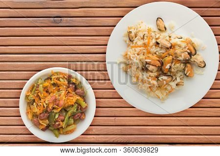 Rice With Mussels And Carrots On A White Plate. Rice With Mussels And Carrots On A Orange Wooden Bac