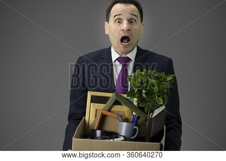 Stressed Handsome Middle Age Businessman Holding Box With His Stuff. Shocked Worried Dismissed Worke