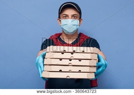 Studio Shot Of Courier Holding Stack Of Pizza Boxes, Delivery Man Giving Order To Client, Waiter Del