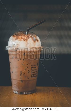 Iced Coffee Mocha In Plastic Glass On Wood Table