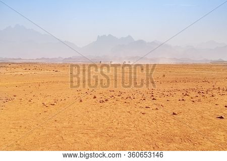 Hot Desert With Mirage On A Background Of Mountains